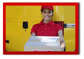courier woman smiling holding a parcel