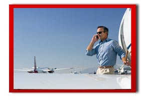 businessman on the phone by a private jet