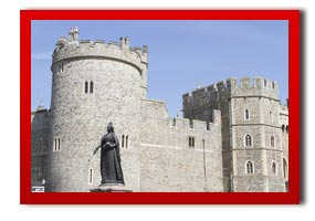 windsor castle with a statue of queen victoria