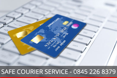 computer keyboard and credit card with safe courier message - 0845 226 8379